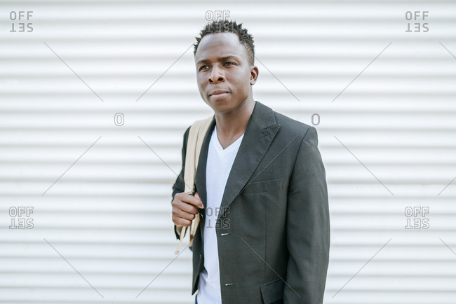 Portrait of serious looking man with backpack