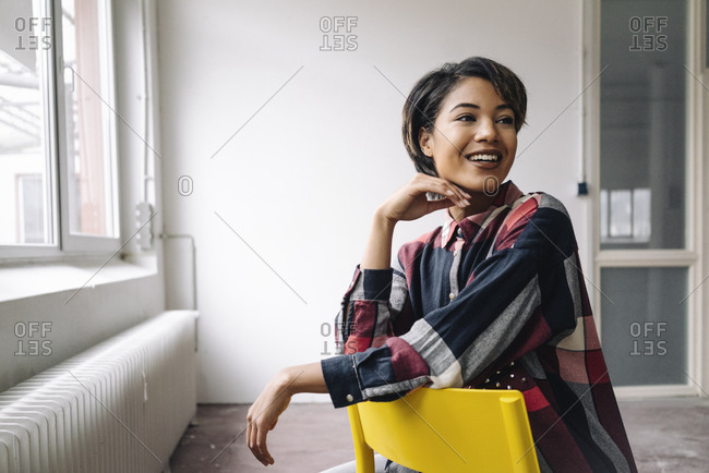 Smiling woman sitting on chair