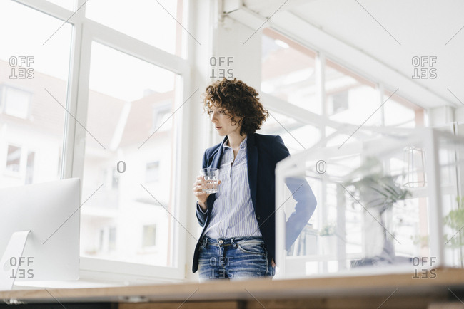 Businesswoman in office looking at computer