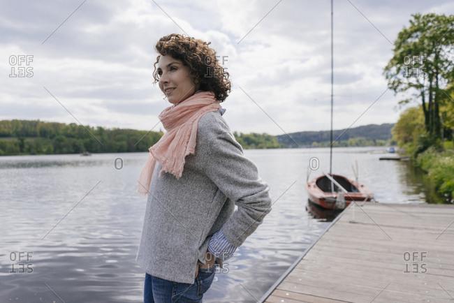 Woman standing at lake looking at view