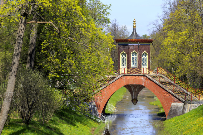 Russia- St. Petersburg- Pushkin- Catherine Park- bridge with building above brook