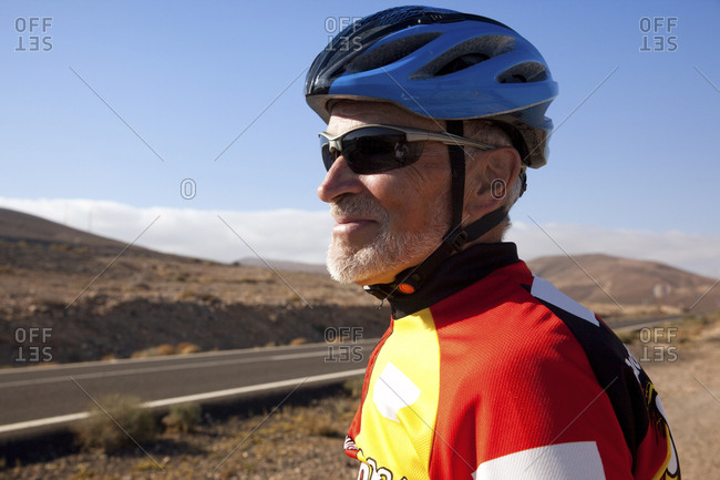 Spain- Canary Islands- Fuerteventura- confident senior man in cycling outfit