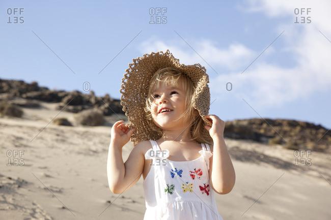 Spain- Fuerteventura- happy girl on the beach
