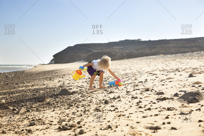 Spain- Fuerteventura- girl playing on the beach