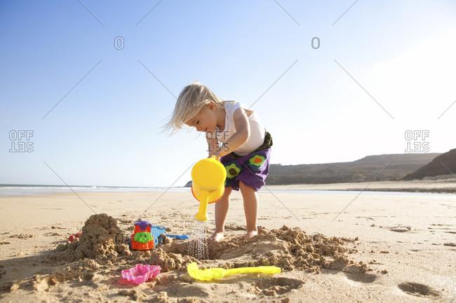Spain- Fuerteventura- girl playing on the beach