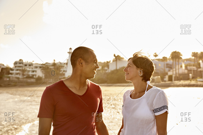 Spain- Canary Islands- Gran Canaria- couple in love face to face on the beach