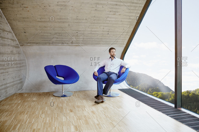 Businessman sitting on chair in attic office
