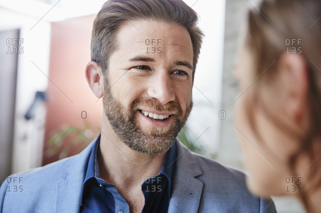Smiling businessman looking at businesswoman