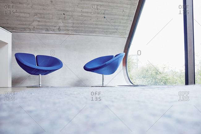 Two chairs in empty attic office
