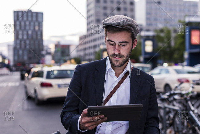 Young man in the city with tablet