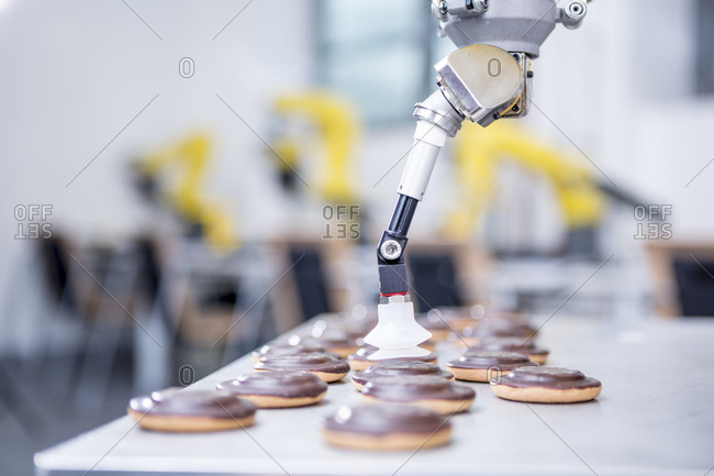 Close-up of industrial robot handling cookies