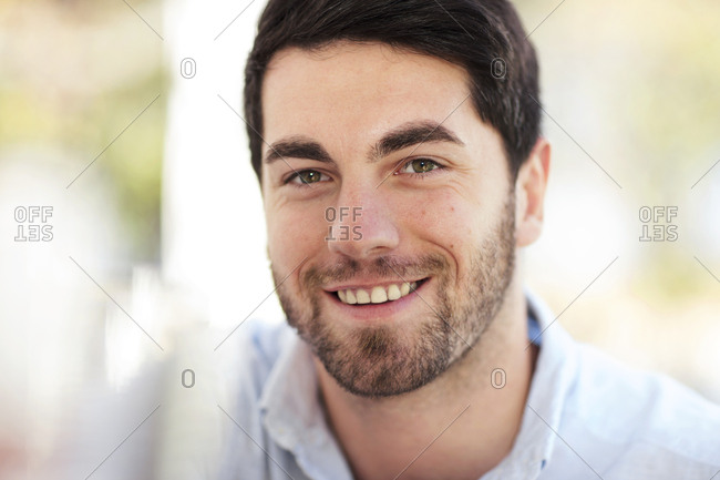 Portrait of smiling young man outdoors