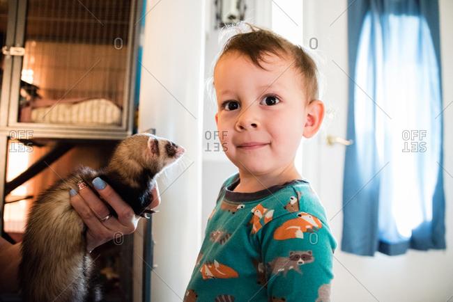 Baby with pet ferret