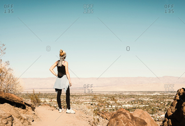 Mid adult hiker looking at view in Palm Springs, California, USA