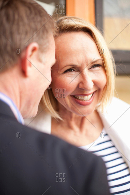 Mature couple smiling together, close up