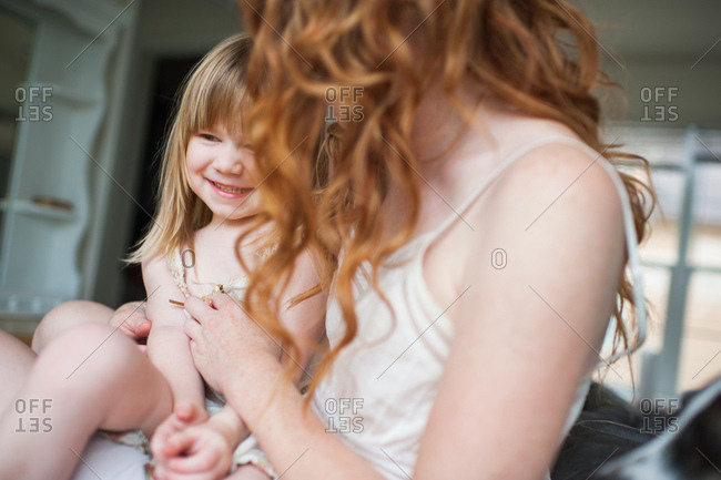 Mother tickling daughter