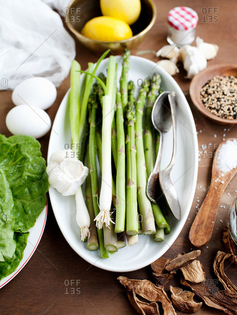 Studio shot of asparagus, surrounded by other ingredients