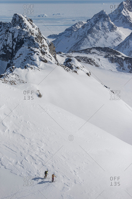 Men skiing in East Greenland