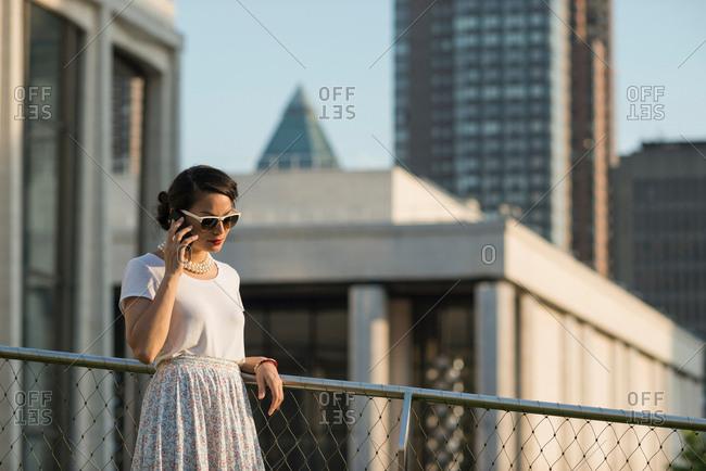 Mid adult women using mobile phone, Manhattan, New York