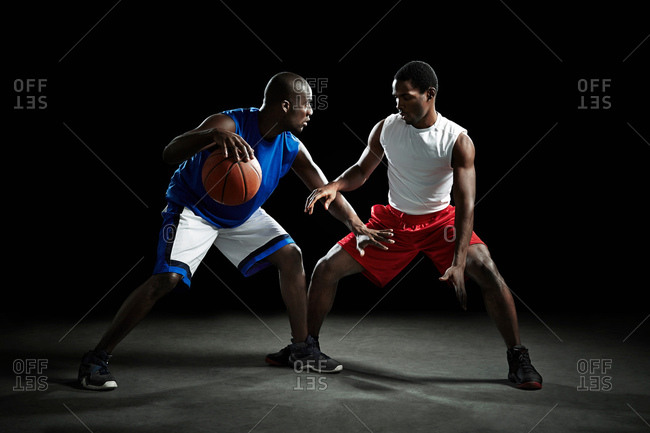 Basketball players competing for ball