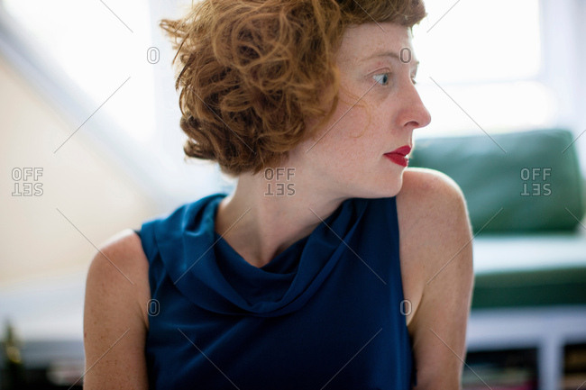 Close up profile of woman in sitting room