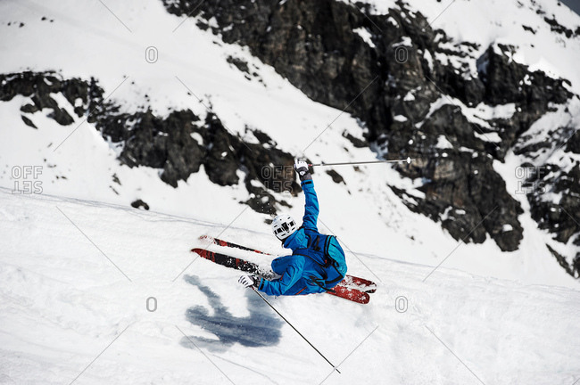 Overhead view of man skiing at speed down mountain