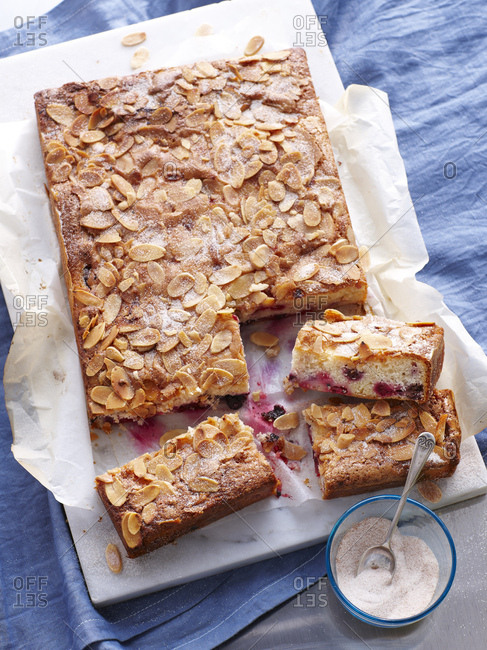 Still life of berry buttermilk slices topped with almonds