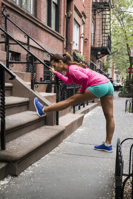 Woman stretching on steps
