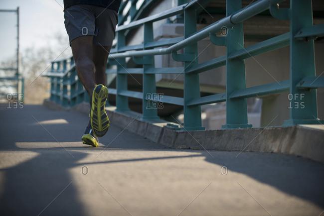 Man jogging on sidewalk