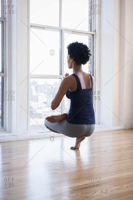 Woman practicing yoga in room