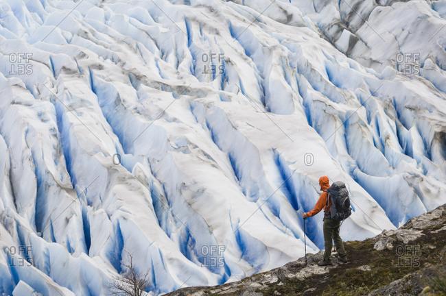 Man by Grey Glacier near Campamento Los Guardas, Torres del Paine National Park, Chile