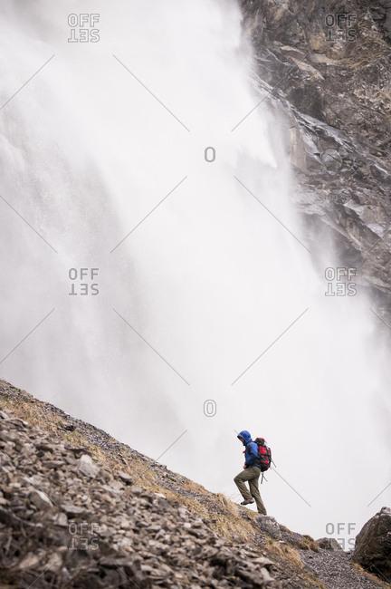 Man hiking near Engstligen falls, Adelboden, Bernese Oberland, Switzerland