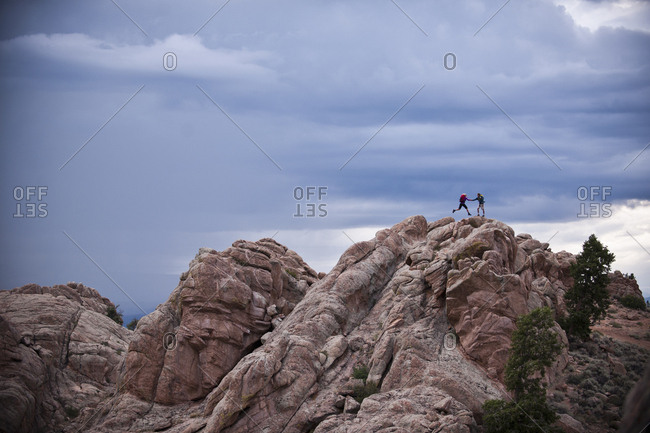 Couple on rocks, Hartman Rocks Recreation Area, Gunnison, Colorado, USA