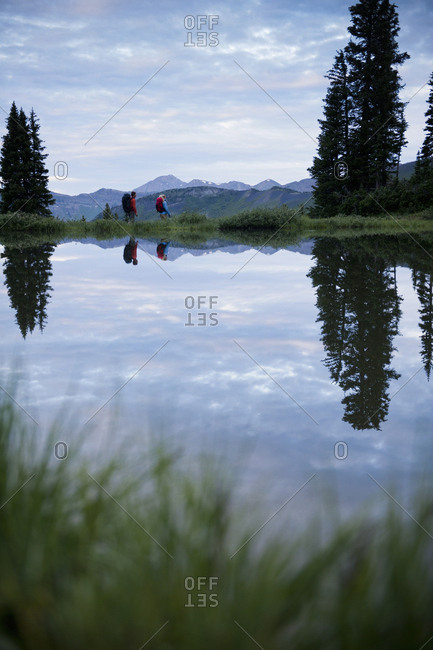 Couple by lake near Paradise Divide, Crested Butte, Colorado, USA