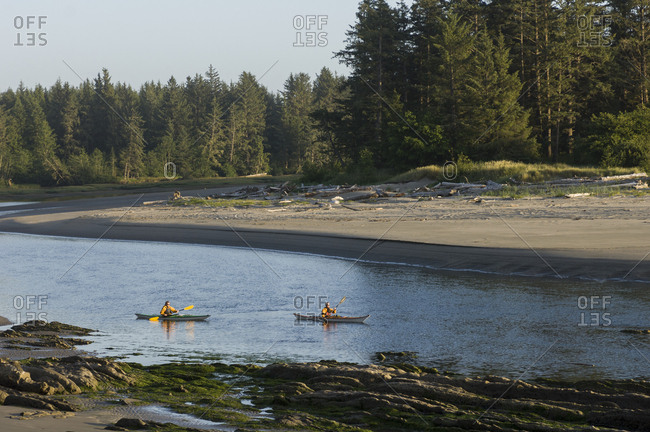 Two men kayaking on Sooes River, Makah Bay, Washington, USA
