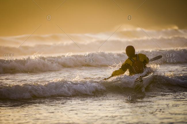 Man kayaking on sea at Bahobohosh Point, Makah Bay, Washington, USA