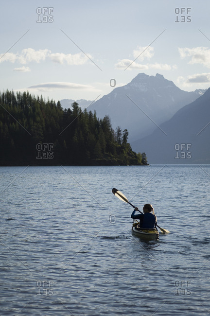 Woman kayaker on St. Mary Lake, Glacier National Park, Montana, USA