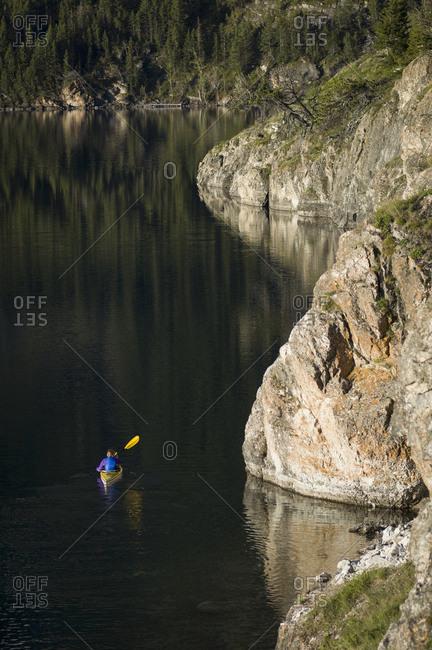 Woman kayaking on St. Mary Lake, Glacier National Park, Montana, USA