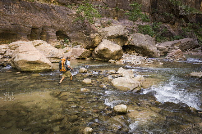 Man backpacking the Narrows, Zion National Park, Utah, USA