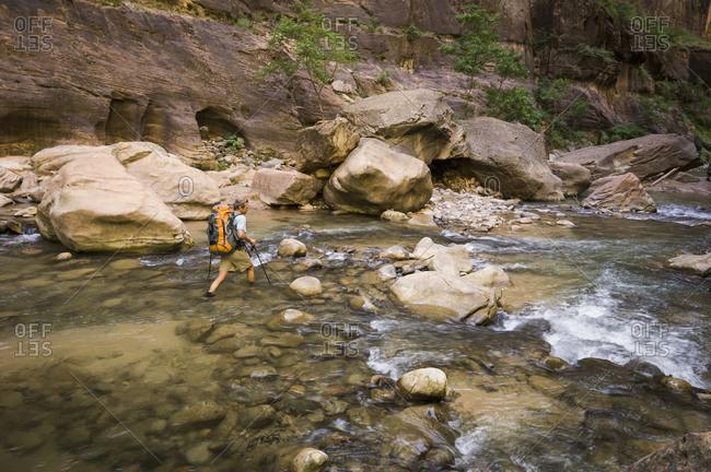Man backpacking the Narrows, Zion National Park, Utah, USA