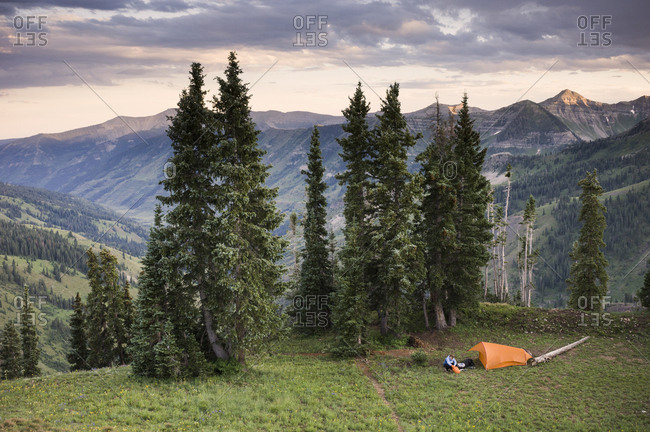 Woman camping near Paradise Divide, Indian Peaks Wilderness, Colorado, USA