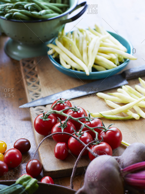 Still life of fresh vegetables with vine tomatoes, zucchini and beetroot