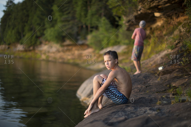 Two teenage boys on lakeside,  Lake Superior, Au Train, Michigan, USA