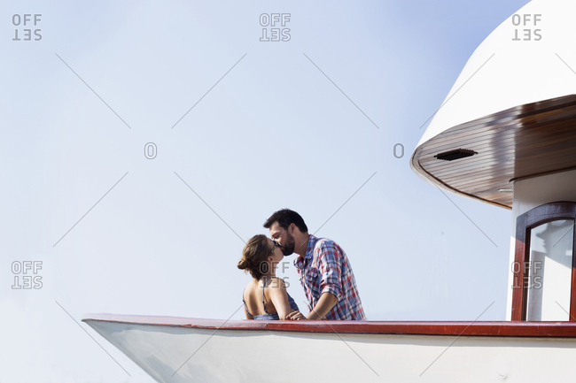 Young couple kissing on boat, Milna, Brac, Croatia