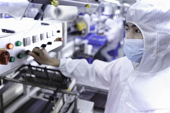 Worker using machinery in electronic cigarette factory