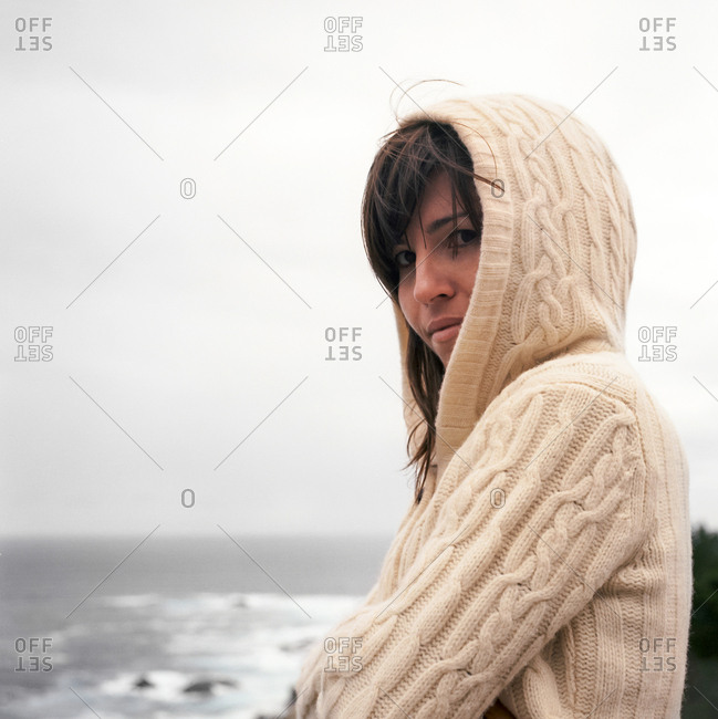 Portrait of woman in hooded sweater, Big Sur, California, USA