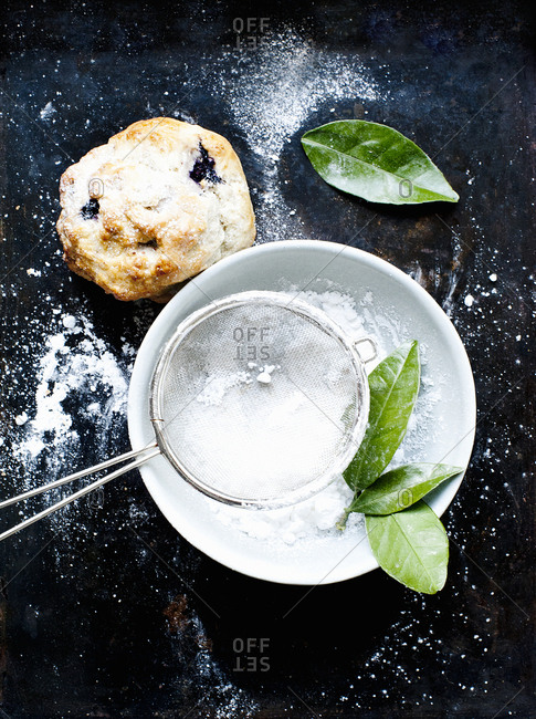 Still life of blueberry scone with caster sugar