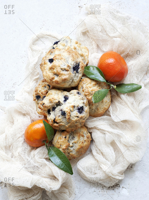 Still life of blueberry scones with tangerines
