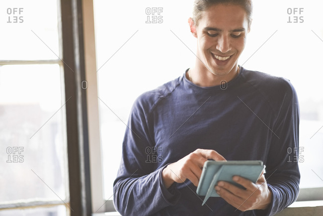 Young man using digital tablet