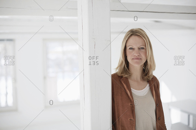 Portrait of mature woman in empty office space